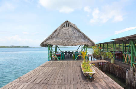 bocas del toro: Tropical bar on the stilts with thatched roof, archipelago of Bocas del Toro, Panama Stock Photo