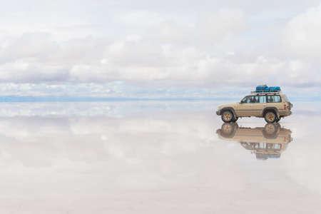 unruffled: Car on the Uyuni Salar in Bolivia Stock Photo