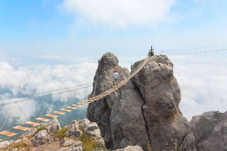 Rope bridge over the precipice on Mount Ai-Petri Stock Photo