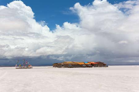 salar: Salt hotel and flags of the states, Salar de Uyuni, Bolivia Stock Photo