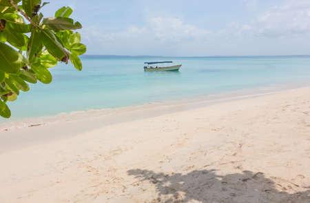 bocas del toro: Deserted beach with boat on the archipelago Bocas del Toro, Panama Stock Photo