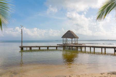 Pier on Boca del Drago beach in the evening, archipelago Bocas del Toro, Panama Stock Photo