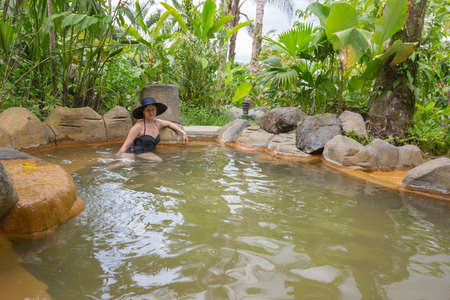 Woman in the thermal springs in Costa Rica at the base of the Arenal Volcano