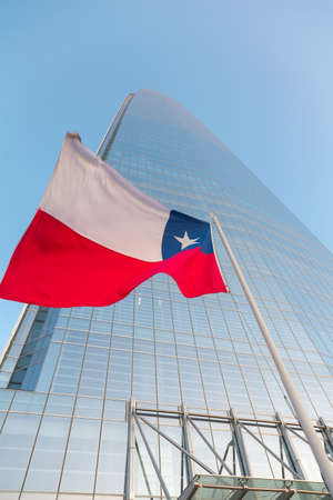 Chilean flag on the background of skyscraper