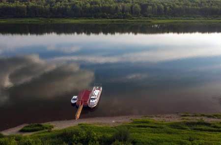 moored: Boat moored on summer day, river