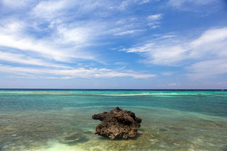 asia pacific: beautiful coastline, turquoise view of the sea with stone, minimal subject, Philippines Asia, Pacific Ocean Stock Photo