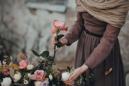 florist girl making a bouquet of roses Stock Photo