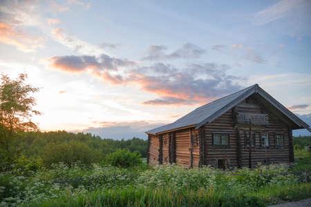 old log farmhouse in the beautiful sky Stock Photo