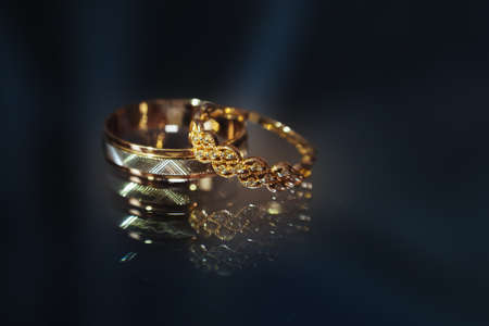 Beautiful wedding golden rings on dark background
