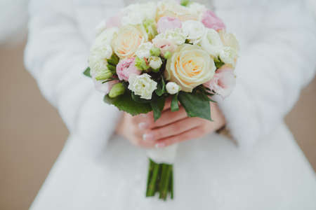 bridal bouquet in hands of the bride