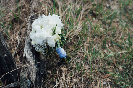 beautiful bridal bouquet of white flowers on the grass Stock Photo