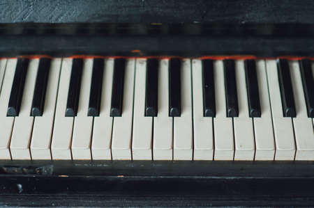 deteriorated: Closeup of vintage piano keyboard. White and black keys Stock Photo