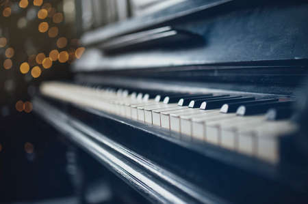 deteriorated: Closeup of vintage piano keyboard. Beautiful blur background
