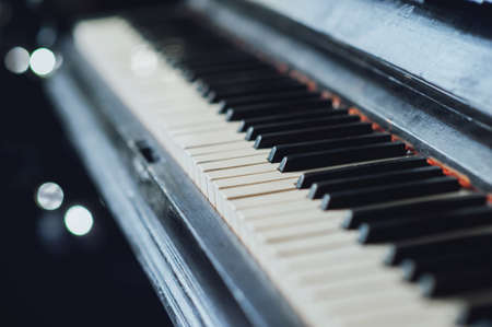 songbook: Vintage old piano. Close-up of keyboard keys Stock Photo