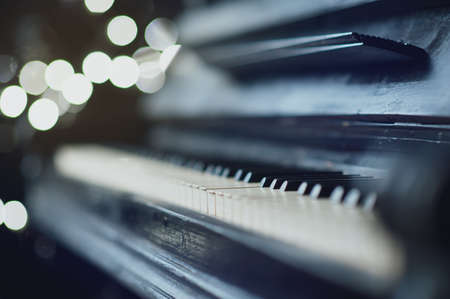 piano closeup: The old black piano. close-up of keys. Beautiful blur Stock Photo