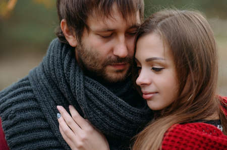 Stylish man and woman in a scarf on nature Stock Photo