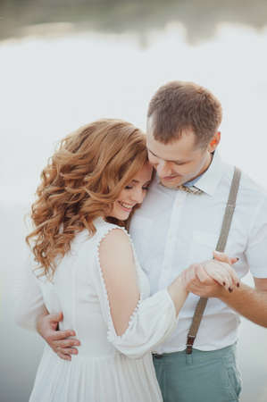 picknick: the bride and groom on the background of a mountain stream Stock Photo