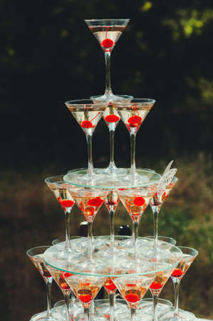 Pyramid glasses. Mount champagne on the table  nature, wedding, catering Reklamní fotografie