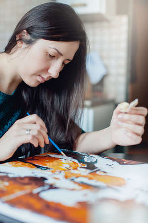 longhaired: girl in a blue dress draws picture paints