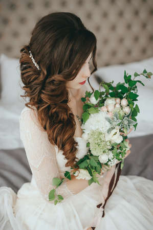 Beautiful bride with fashion wedding hairstyle In a hotel Stock Photo