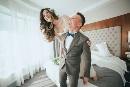 bride and groom having fun in bed