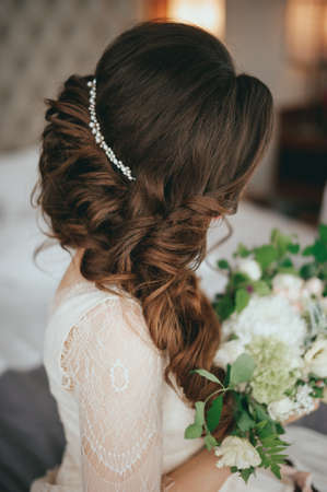 Beautiful bride with fashion wedding hairstyle In a hotel Reklamní fotografie