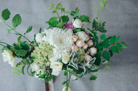 Stylish wedding bouquet from different colors on the bed Banco de Imagens