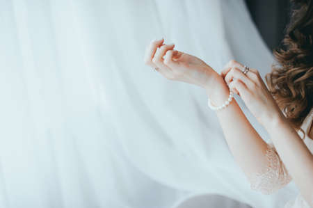 the bride wears a bracelet on hand Stock Photo