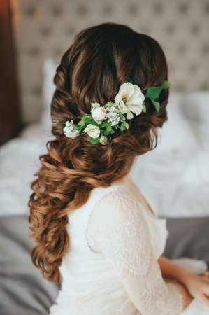 Beautiful bride with fashion wedding hairstyle In a hotel Archivio Fotografico