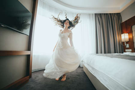 claret: The bride is having fun at the hotel