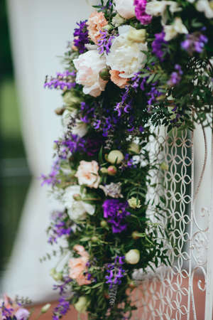 Wedding decorations. Bouquet of white and purple flowers