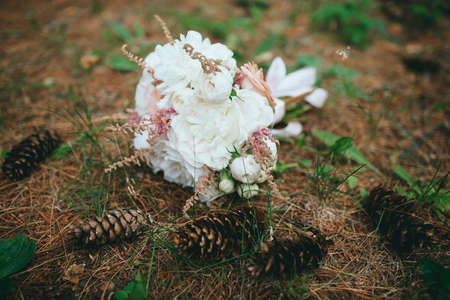 stylish beautiful bridal bouquet from different flowers
