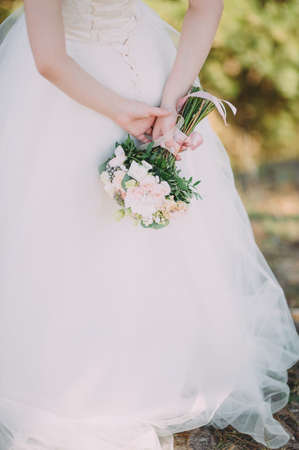 Beauty bride in bridal gown with bouquet