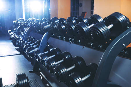 A set of dumbbells in the gym. Sports equipment Stock fotó