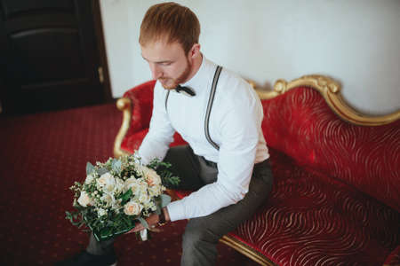 Stylish groom with beard waiting for the bride 写真素材