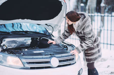 the girl repairs the car. road accident