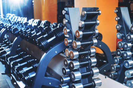 A set of dumbbells in the gym. Sports equipment Stock fotó - 96931207