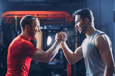 Arms wrestling, competition, strength comparison. arm in arm the opposition athletes