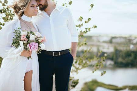 bride and groom walking outdoors at the wedding Archivio Fotografico