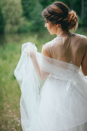 Beautiful bride posing in her wedding day Stock Photo