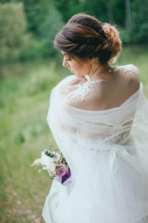 Beautiful bride posing in her wedding day Banco de Imagens