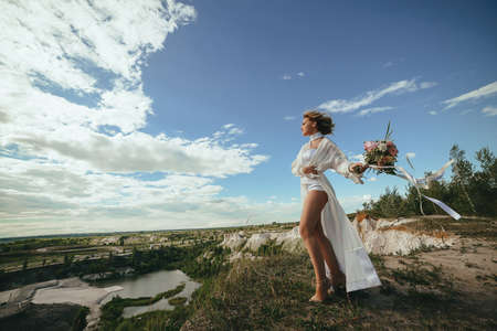 Beautiful portrait of bride with a bouquet in a flying dress