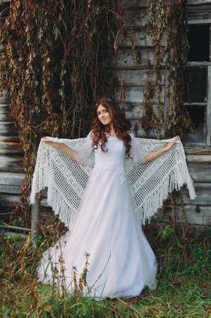 portrait of a beautiful bride in a handkerchief. rustic style. boho. fine art Imagens