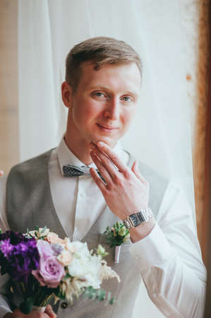 Handsome groom at wedding tuxedo waiting for bride. Rich groom at wedding day Stock Photo