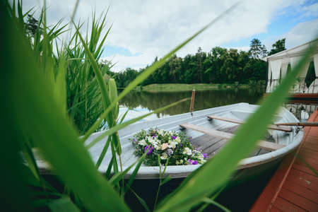boat with a bouquet on the banks of the river
