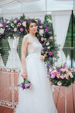 Beautiful bride posing at field of lavender Stock Photo