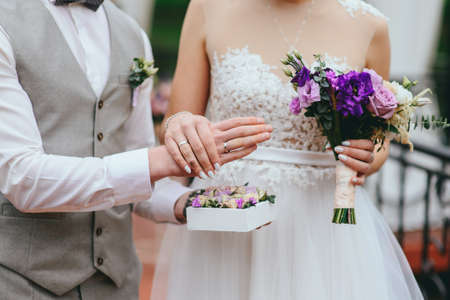 bride and groom exchange rings at the wedding Stock Photo