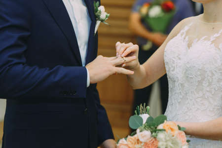 Wedding ceremony. wedding reception.the bride wears a ring on her finger