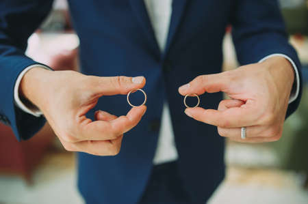 the bridegroom holds in the hands of wedding rings. preparation of the groom Stock Photo