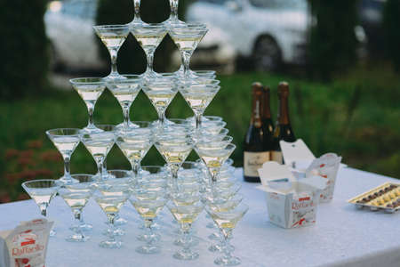 Champagne glasses. Wedding slide champagne for bride and groom. Stock Photo